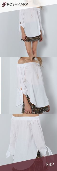 LAST ONENWT White Knotted Off The Shoulder Top White off the shoulder top. The perfect top for the office and a girls night out. Pair this with your favorite pair of jeans or a pencil skirt and some killer heels!  Clothing Length(cm) : S:61cm, M:62cm Sleeve Length(cm) : S:47cm, M:48cm Bust(cm) : S:96cm, M:100cm Color : White Sleeve Length : Long Sleeve MMC Tops Blouses
