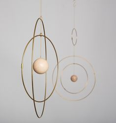 GO TO SHOP Galaxy Globe is a collection of eloquent mobiles, made from light brass rings that slowly move around each other with a marble sphere in the center, resembling… Rose Vintage, Vintage Rosen, Mobiles, Ravenclaw, Kenzo World, Kenzo Parfum, Quilt Inspiration, Baby Mobile, Idee Diy