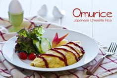 Omurice is a classic Japanese Yoshoku recipe, savory chicken ketchup fried rice wrapped in a thin layer of egg.