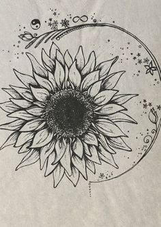 Sunflower tattoo and I love the ring around it.