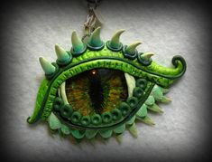 First time working with polymer clay… created a pendant with one of my hand pa… Das erste Mal mit Fimo … Polymer Clay Dragon, Polymer Clay Animals, Polymer Clay Crafts, Diy Clay, Polymer Clay Jewelry, Polymer Clay Miniatures, Polymer Clay Projects, Dragon Crafts, Dragon Eye
