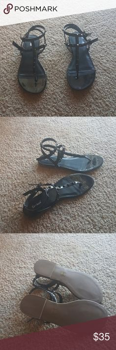 Black sandals A new, never worn pair of black sandals. Black, pointy studs on straps. Limelight Shoes Sandals