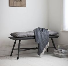 A stunningly handcrafted benchDark or Light grey wash option availableElegantly turned legs from reclaimed teak wood make up this beautiful bench. Perfect to drape your clothes on at the end of your bed or for an ideal seat in a narrow hallway.  Wherever you decide to position this its a beautifully piece of furniture. Available in a light grey wash or dark stained version Reclaimed teak - clean with a dry cloth and position away from direct heat sources.47cm W x 1150cm L x 47cm H 7kg
