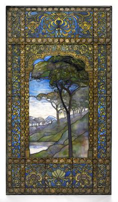 A good Tiffany leaded Favrile glass and pebble landscape window   This use of pebbles to enhance leaded glass window design or as material for a lampshade has been suggested by Alastair Duncan to be the contribution of Joseph Briggs ( born in Lancashire arrived at Tiifanys age 18) the general foreman of Tiffany Studios & a good friend of LC Tiffany