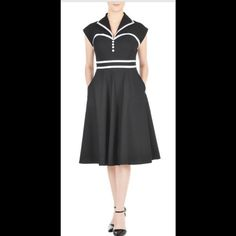 "New Eshakti Black Fit & Flare Dress 14 New Eshakti black fit & flare retro style dress. Size 14 Measured flat: underarm to underarm: 37"" Waist: 33 ¾"" Length: 39"" Eshakti size chart for bust size 14: 40"" Faux-front button placket, dolman cap sleeves. Sweetheart bodice w/darts to shape. Contrast trim, side seam pockets, side hidden zipper. Cotton, woven poplin, pre-shrunk, smooth finish, light crisp feel, no stretch, mid-weight. Machine wash. eshakti Dresses"