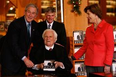 Billy Graham with son Franklin and President and Mrs. George W. Bush at the Billy Graham Library