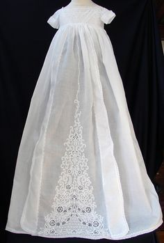 """""""Exquisite 19th C. Ayrshire Christening Gown    Circa mid 1800's, superb Ayrshire embroidery on this delightful gown. The bodice is encrusted heavilly with fine whitework and the unusual sleeves are also heavilly embellished. A lovely pyramid shaped design on the skirt with fine Ayrshire work on the wings and all around the edges. The Ayrshire embroidery is quite superb, a truly beautiful gown!"""""""