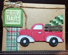 """Cute Red Christmas Truck. Start with 5x6.5"""" pre-made craft card and envelope.  Cricut cartridges:  Just Because Cards (pg 42) truck and parts cut at 6"""". Create A Critter2 (pg 70) tree icon in dk green and icon layer in lt green cut at 3"""". Use markers to add details and dimension.  Add a strip of tartan plaid paper down side. Stamp sentiment and cut out with Sizzix squares. Pop up sentiment and truck on foam dots. Created by: Melanie Weise"""