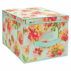 """Canvas storage tote with an ikat floral motif.   Product: Storage boxConstruction Material: CanvasColor: Teal, pink and greenDimensions: 12"""" H x 10"""" W x 16"""" D"""