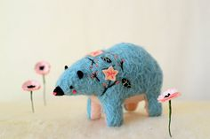 *reserved*    this sweet bear marks the springs return. she follows the sakura as they blossom across the island of japan to sip sake and celebrate spring with her friends.    sakura bear is handcrafted from teal mohair with tons of carefully embroidered x applique details and measures 4 x 5 inches.    comes in a gift box ready to give, or just for you.