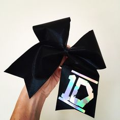Huge black spandex Holographic 1D big cheer hair bow ($15) ❤ liked on Polyvore featuring accessories, hair accessories, one direction, black hair accessories, black hair bow, hair bows and hair bow accessories
