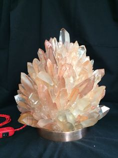 25 kg natural Rose Quartz hand assembled on cooper base. 40cm tall 34 cm diameter