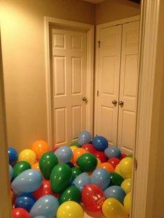 Balloons outside a child's bedroom for a birthday morning surprise!