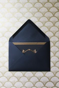 dark envelope, dark paper, pop of gold