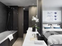 Hotel Cubo, Ljubljana, Slovenia is a 26-room hotel in a pre-Cubist nineteenth-century building on the edge of the old town. - I like the way bathroom is divided from the bedroom, by a moving glass wall