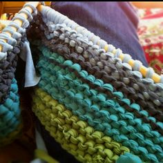 Cute #knit rug using old t-shirts! That's right, you can turn old t-shirts into yarn. Pretty neat!