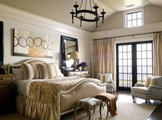 Love this bedding, especially the curved upholstered headboard and footboard