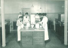Students cooking in a home economics laboratory and classroom, The University of Iowa, 1910s