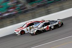 Kevin Harvick Photos Photos - Ryan Blaney, driver of the #21 Motorcraft/Quick Lane Tire & Auto Center Ford, races Kevin Harvick, driver of the #4 Jimmy John's Chevrolet, during the NASCAR Sprint Cup Series Go Bowling 400 at Kansas Speedway on May 7, 2016 in Kansas City, Kansas. - NASCAR Sprint Cup Series Go Bowling 400