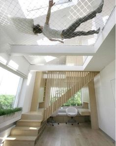 use extra high ceilings to create a super hammock from the upper level