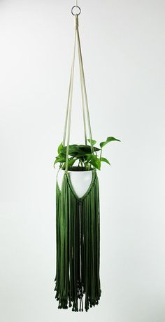 "Original Macrame Plant Hanger, modern macrame, in noble beautiful green color! 100% handmade 100% natural cotton cord Total length: 146 cm (57,5"") (Please note – plant and pot not included in the offer). We ship WORLDWIDE! Shipping to Europe normally takes 5-8 working days, to US and"