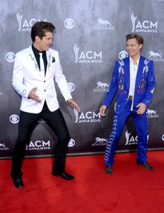 """It was a battle of the Rhinestones on the 2014 ACM awards Red Carpet """"Singers Jon Pardi and Frankie Ballard attend the 49th Annual Academy... News Photo 483111967"""