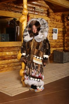 Woman in traditional Native muskrat coat