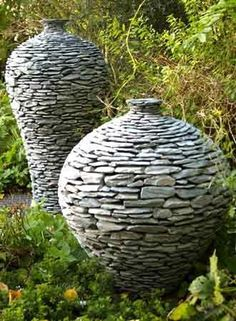 Rock Planters - Pretty easy to make, covering a plain clay pot, with rocks, using construction adhesive.