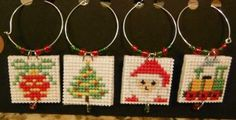Cross Stitch Wine Glass Charms CHRISTMAS Set of 4 - Ornament, Tree, Santa & Train by CraftyCrossStitches for $10.00