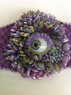 SOLD/ Purple and green eyeball  bracelet by UniqueandMacabre, $200.00