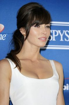 Jessica Biel channels the '60s with a bouffant ponytail and modern bangs.