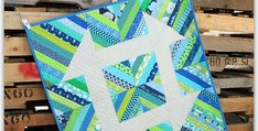 A Stunning Little Quilt in Any Color Combo! Take one traditional quilt block, super size it, stitch it together with modern vividly colored prints, and what do you have? This gorgeous Churn Dash quilt. This easy quilt looks wonderful in just about any fabric line. It's also quite easy to make using foundation paper-piecing. Plus, …