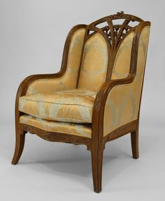 French Art Nouveau walnut bergere arm chair with carved floral trim and filigree back (LOUIS MAJORELLE) Price $21,500.00
