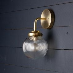 This Vintage Brass Wall Sconce fixture features-Raw Brass Mount-Raw Brass pipe-Holophane Ribbed Clear Glass / 220 Watts Max-UL Listed-Mounting Bracket and Screws Included Size - Projection X 11 in HeightBase Size - Diameter-Light bulb not included. Vintage Wall Sconces, Bathroom Wall Sconces, Wall Fixtures, Hall Bathroom, Bathrooms, Milk Glass Lamp, Brass Pipe, Fan Decoration, Brass Sconce