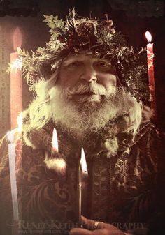 The Holly King frequently appears as a woodsy version of Santa Claus. He dresses in red, wears a sprig of holly in his tangled hair, and is sometimes depicted driving a team of eight stags. The Oak King is portrayed as a fertility god, and occasionally appears as the Green Man or other lord of the forest.