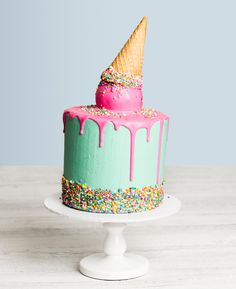Ice Cream Cone Drip Cake - this phenomenal cake is so life-like you'll be tempted to lick the sides. Don't get too carried away though, make sure you share this Ice Cream Cone Birthday Drip Cake with your friends this summer.