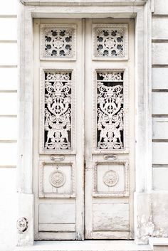 A beautifully aged Parisian door in a neutral shade.
