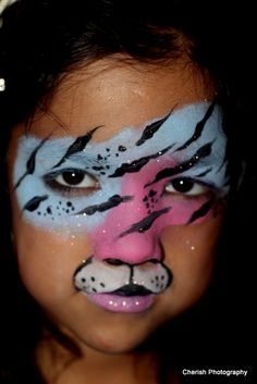 DIY TIger Mask Face Paint. Only thing is if the kids do water games this will wash off.