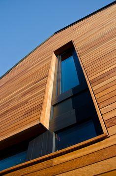 Wonderful Techniclic cladding in Iroko wood Wood Cladding Exterior, Larch Cladding, Wood Facade, House Cladding, Modern Bungalow Exterior, Window Reveal, External Cladding, Timber Windows, Wood Panel Walls