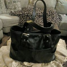 Just 4 U! Kenneth Cole Tote Black leather with two side pockets,  spacious nylon interior cosmetic zipper pocket and multiple open ones.  Exterior also features large front and rear pockets, matching black adjustable handles with silver buckle hardware. Pre loved,  good condition, only minor signs of wear on Top handle edges. Kenneth Cole Reaction Bags Totes