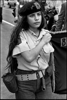 1981. A Dallas chapter member of the Brown Berets, a Xicana/o revolutionary group, organized in the late 1960's, at a police brutality demonstration.