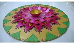 This festive rangoli is made using a canvas sheet and is brightly painted to add colours to your celebrations. This rangoli can also be used to keep a tealite in the house or as a centre table piece Hobby Ideas, Center Table, Rangoli Designs, Handmade Home Decor, Diwali, Diys, Colours, Canvas, Holiday Decor