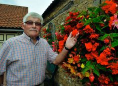Green-fingered Stuart Grindle, spends 30 hours a week pruning, weeding and trimming his stunning garden at his and wife Anne's home in Rotherham, Yorkshire.