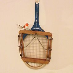 """""""Little robins all over in the living room at home for Christmas. Particularly like this little chap. #Christmas #robins #home #tennisracquet #vintage…"""""""