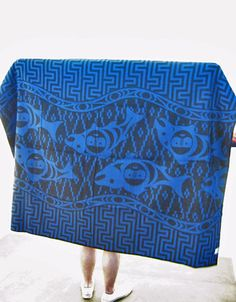 Blanket by Engineered Garments and Faribault Woolen Mills Co. Salmon People Wool Jacquard construction. The collaboration sees a range of blankets, jackets and bags play host to two Cherokee-influenced textiles, merging Engineered Garments' signature utilitarian style and practical detailing with Faribault's expertise in woolen product design and their strong links to heritage. The result is essential kit for both modern day mountaineers and urban jungle adventurers.
