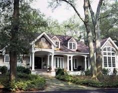 love this little house,I see a cottage hidden behind tall tree next to lake......or on a tree lined street....perfect beach house....no matter were you build it that porch just says come set for awhile and chat....