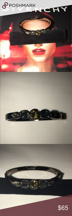 "Givenchy Gunmetal Givenchy hinge bracelet featuring multicolor crystal embellishments and box clasp closure. Fit: Fits a wrist size of 6.50"" or smaller. Metal Type: Gunmetal Hallmark: Designer-Signature Signature: Givenchy Location: Interior Surface Metal Finish: High Polish Total Item Weight (g): 28.3 Non-Gem Materials: Crystal                   Measurements: Inside Circumference 7"", Width 0.25"" Designer: Givenchy Givenchy Jewelry Bracelets"