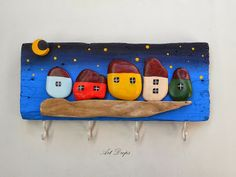 Art Drops: stone houses and drift wood on a piece of old wood. Add hooks and hang your keys up