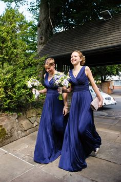 Love the flowers with the dresses! navy bridesmaid dresses http://daffodilwaves.co.uk/