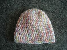 Crochet baby beanie hats   My last project in March has been to make these cute little crochet baby beanie hats.   Individually t...